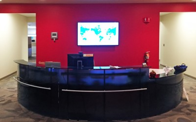 reception desk with large monitor